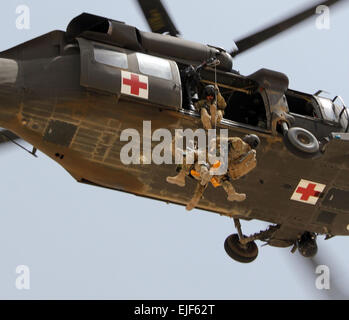 Staff Sgt. Travis Brown, a flight medic assigned to Company C, Task Force Lobos, 1st Air Cavalry Brigade, 1st Cavalry - Stock Photo