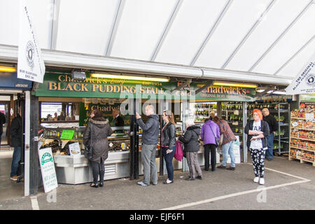 Bury Market day and a black pudding stall at Bury in Greater Manchester - Stock Photo