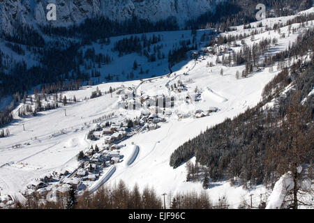 The village of Colfsco in the valley beneath The Selle GruppeThe Alta Badia Dolomites Italy - Stock Photo