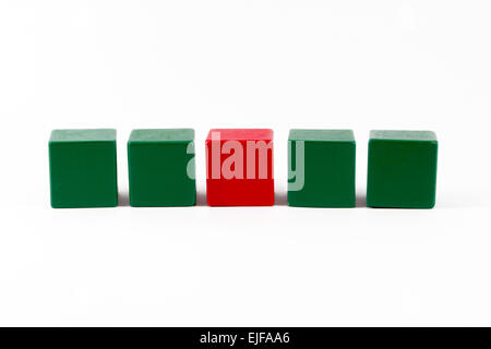 Children's wooden building blocks in green and red - Stock Photo