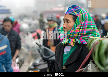 Hmong woman at a market in Sapa, Vietnam - Stock Photo