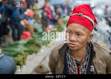 Red Dao woman at the market in Sapa in northern Vietnam - Stock Photo