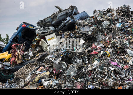 Metal recycling of cars, autos and other scrap metal to avoid environmental pollution in England - Stock Photo