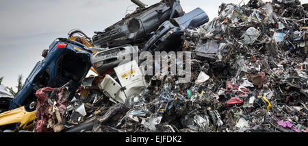 Metal recycling of scrap metal, cars and autos to avoid environmental pollution in England - Stock Photo