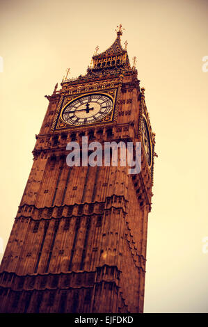 closeup of the Big Ben in London, United Kingdom, vignetted and with a retro effect - Stock Photo