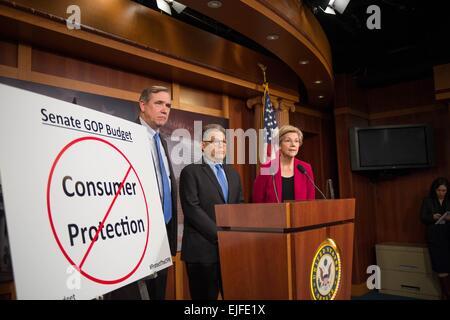 US Senator Elizabeth Warren joined by Senators Al Franken and Jeff Merkley comments on the Senate Republican budget - Stock Photo