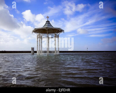 The bandstand on Southsea seafront surrounded by flood water caused by extreme high tides, Portsmouth Hampshire, - Stock Photo