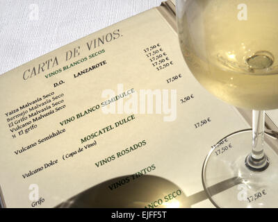 WINE MENU LANZAROTE Glass of chilled white wine and restaurant wine list with selection of Lanzarote wines on offer - Stock Photo