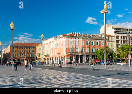 NICE, FRANCE - OCTOBER 2, 2014: Place Massena is the main pedestrian square of the city with modern statues on tall - Stock Photo