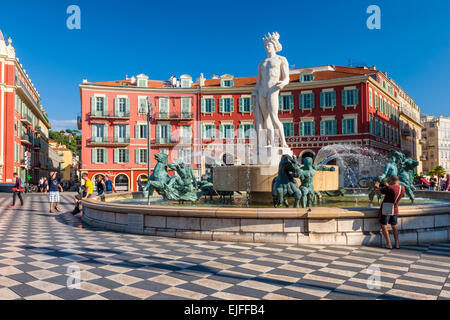NICE, FRANCE - OCTOBER 2, 2014: Fountain of the sun or Fontaine du Soleil with statue of Apollo at Place Massena - Stock Photo