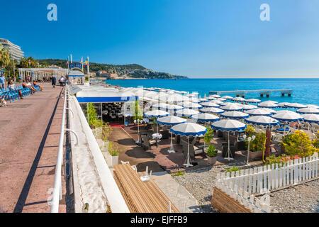 NICE, FRANCE - OCTOBER 2, 2014: English promenade or Promenade des Anglais runs along the city beach with restaurants - Stock Photo