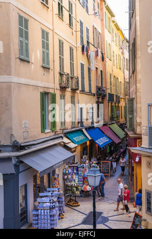 NICE, FRANCE - OCTOBER 2, 2014: Shops, cafes and restaurants on Rue du Pont-Vieux, a narrow pedestrian street in - Stock Photo