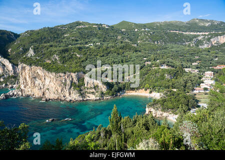 Paleokastritsa beach resort - blue sky, cliffs and turquoise Ionian Sea in Corfu, Ionian Islands, Greece - Stock Photo