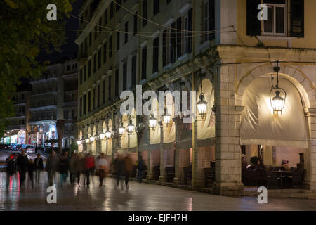 People strolling at night by the Spianada in Kerkyra, Corfu Town, Greece - Stock Photo