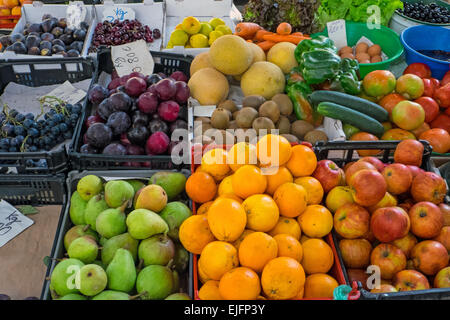 Various fruits for sale at a market - Stock Photo