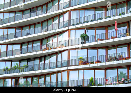 Facade of modern hirise building with many balconies - Stock Photo