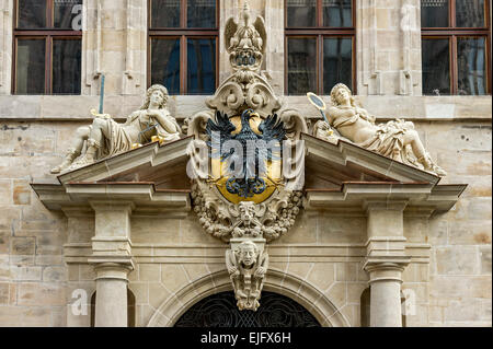 Crest with eagle and allegorical figures, Office of the Nuremberg Reichsschultheiß or Imperial mayor, Old City Hall - Stock Photo