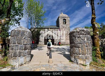 Spain, Galicia: Pilgrim entering in the church Santa Maria of mountain village O Cebreiro - Stock Photo