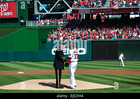 U.S. Army Chief of Staff Gen. Raymond T. Odierno hands the first baseball to pitcher Edwin Jackson prior to the - Stock Photo
