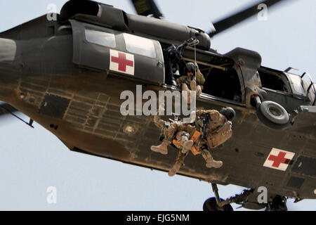 CAMP MARMAL, Afghanistan— Staff Sgt. Travis Brown, a flight medic assigned to Company C, Task Force Lobos, 1st Air - Stock Photo