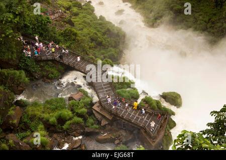 Argentina, Iguazu Falls, visitors on lower trail, Circuito Inferior, viewpoint below Salto Bossetti - Stock Photo