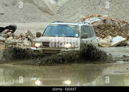 Mitsubishi Shogun off roading in a Quarry. - Stock Photo