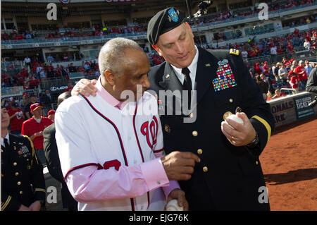 U.S. Army Chief of Staff Gen. Raymond T. Odierno shows a baseball to Hall of Famer Frank Robinson, the first Nationals - Stock Photo
