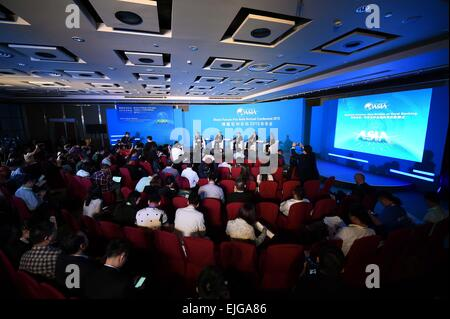Boao, China's Hainan Province. 26th Mar, 2015. Participants attend a sub-forum with the theme of 'Inclusive Finance: - Stock Photo