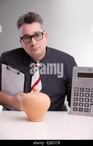 a serious accountant staring at you to discuss about money - Stock Photo