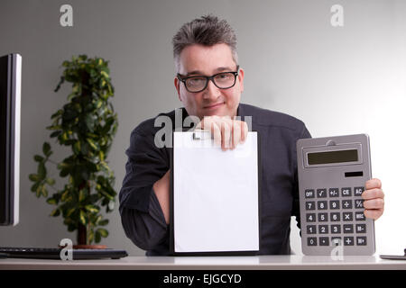 happy and satisfied smiling accountant giving good news about the books - Stock Photo