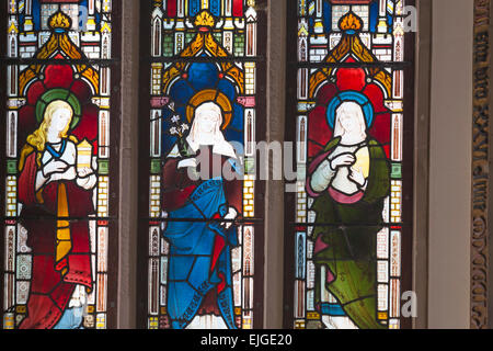 detail of stain glass window depicting the Three Marys in St Mary's Church at Tyneham Village, Dorset UK in July - Stock Photo