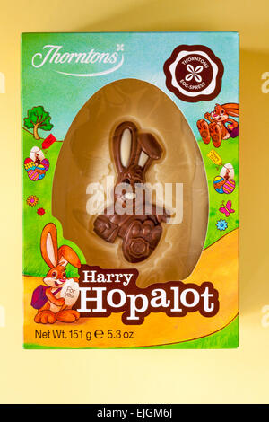 Thorntons Harry Hopalot white chocolate Easter bunny rabbit egg isolated on yellow background ready for Easter - Stock Photo