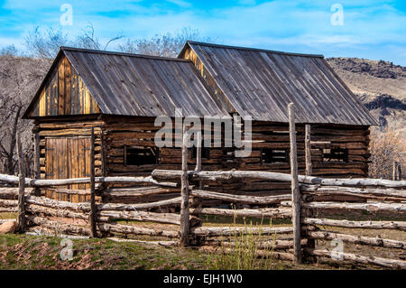 An Old Wooden Barn And Split Rail Fence Along The Quilt