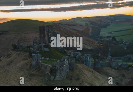 Dawn over Corfe Castle in Dorset - Stock Photo