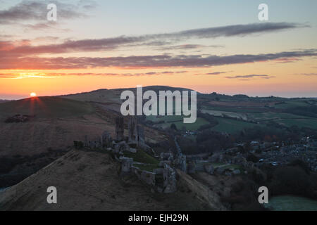 A new dawn over Corfe Castle in Dorset - Stock Photo