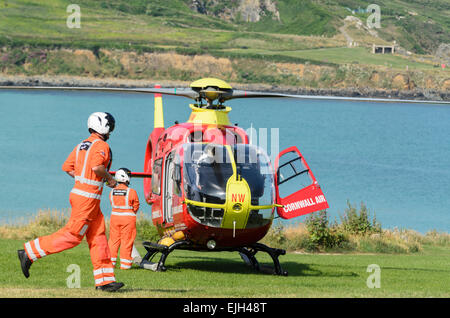 Eurocopter EC135 of Cornwall Air Ambulance about to take off from St Ives, Cornwall, U.K. - Stock Photo