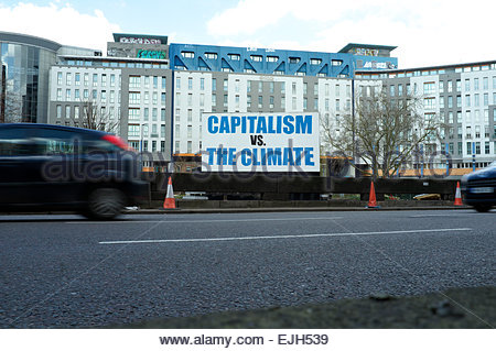 Capitalism vs The Climate - large message in the Bearpit, a creative area within St.James Barton Roundabout, Bristol, - Stock Photo