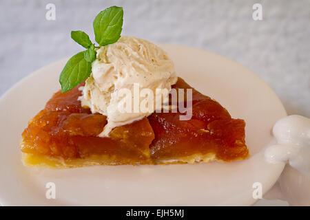 Apple tarte-tatin with vanilla ice cream (egg-free) - Stock Photo