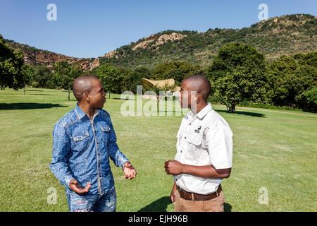 Johannesburg South Africa African Roodepoort Walter Sisulu National Botanical Garden Witwatersrand Black man talking - Stock Photo