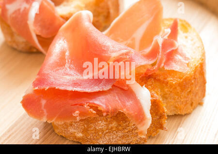 Hamon on a piece of toasted bread closeup - Stock Photo