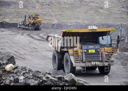 WESTPORT, NEW ZEALAND, MARCH 4, 2015: Trucks at work at an open cast coal mine on March 4, 2015 near Westport, New - Stock Photo