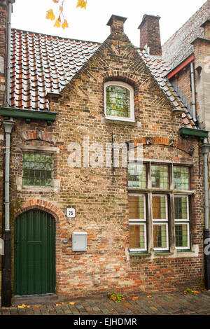House and architectural detail in Bruges, Belgium - Stock Photo