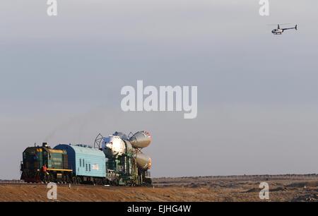 Baikonur, Kazakhstan. 25th Mar, 2015. A Soyuz FG rocket carrying Russia's Soyuz TMA-16M spacecraft seen before being - Stock Photo