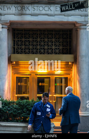 People at back entrance to New York Stock Exchange, New York City, USA - Stock Photo