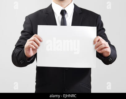 Businessman acting show paper for something communicate - Stock Photo