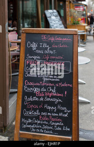 Chalkboard menu outside cafe restaurant Illy in Paris, France - Stock Photo