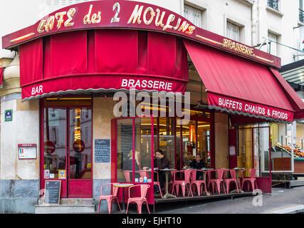 Outdoor cafe restaurant Cafe les Deux Moulins in Paris, France - Stock Photo