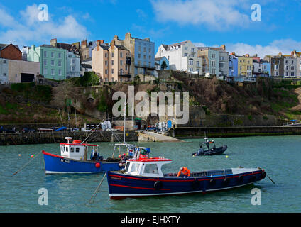 Fishing boats in the harbour at high tide, Tenby, Pembrokeshire, Wales UK - Stock Photo