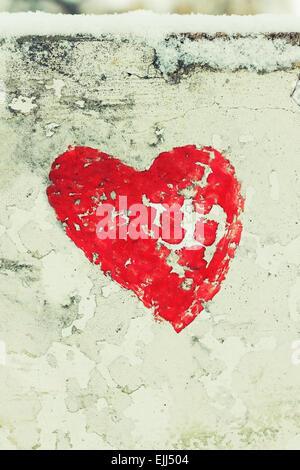 Red Love Heart hand drawn on concrete wall grunge textured background. Winter season, closeup, vertical shot - Stock Photo