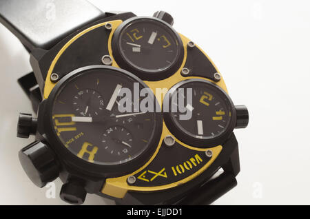Gold and black watch isolated on white background - Stock Photo